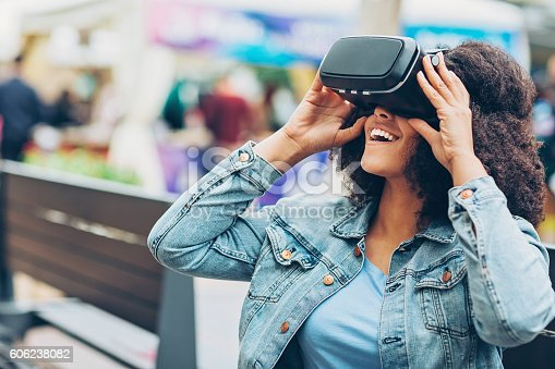 609822310istockphoto Young woman with virtual reality headset 606238082