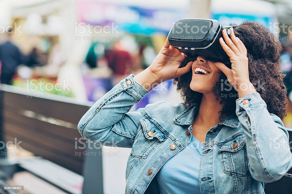 Young woman with virtual reality headset stock photo