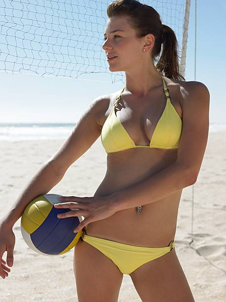 Young woman with volleyball stock photo