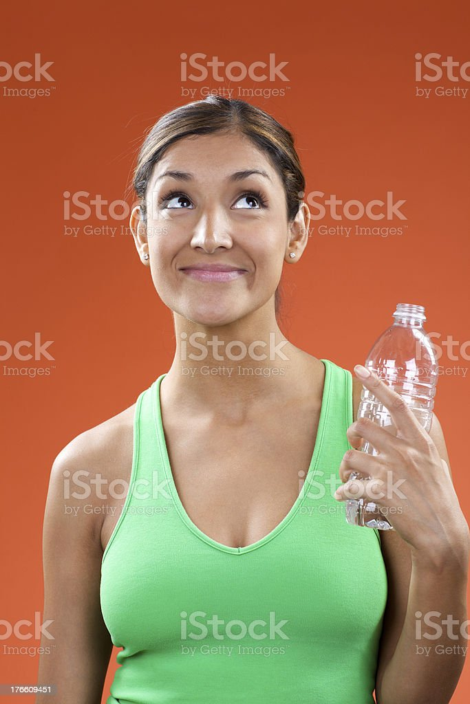 Young woman with water wearing green athletic top royalty-free stock photo