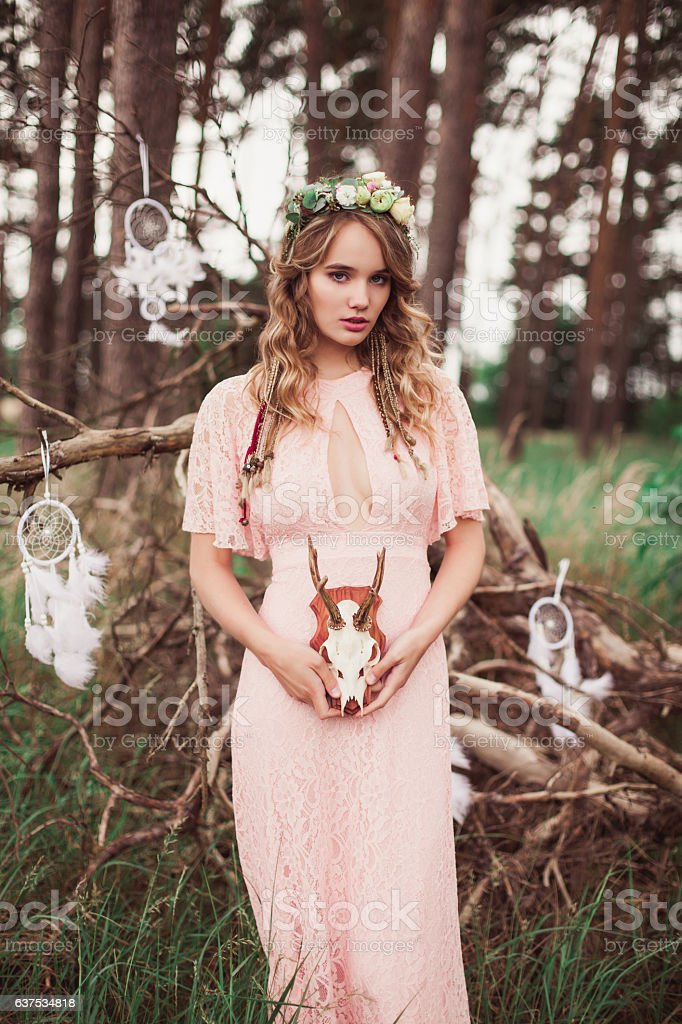 Young Woman With Whitetail Deer Skull And Antlers stock photo