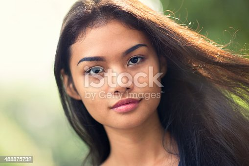 istock Young woman with wind in her hair 488875732