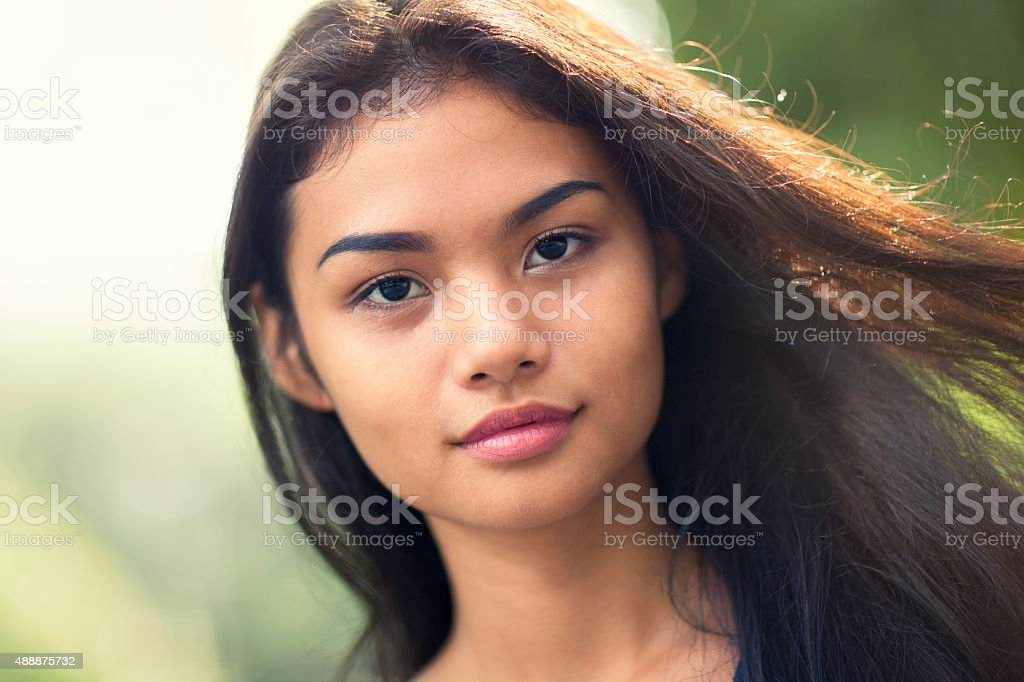 Young woman with wind in her hair stock photo