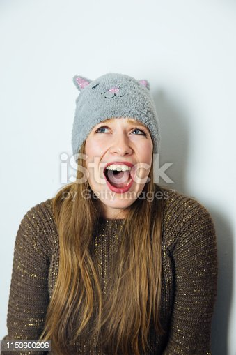 Attractive Long Haired Woman with Hat Feeling Surprised and Yelling