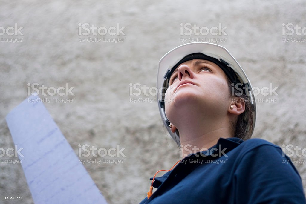 Young woman with work helmet and check list royalty-free stock photo