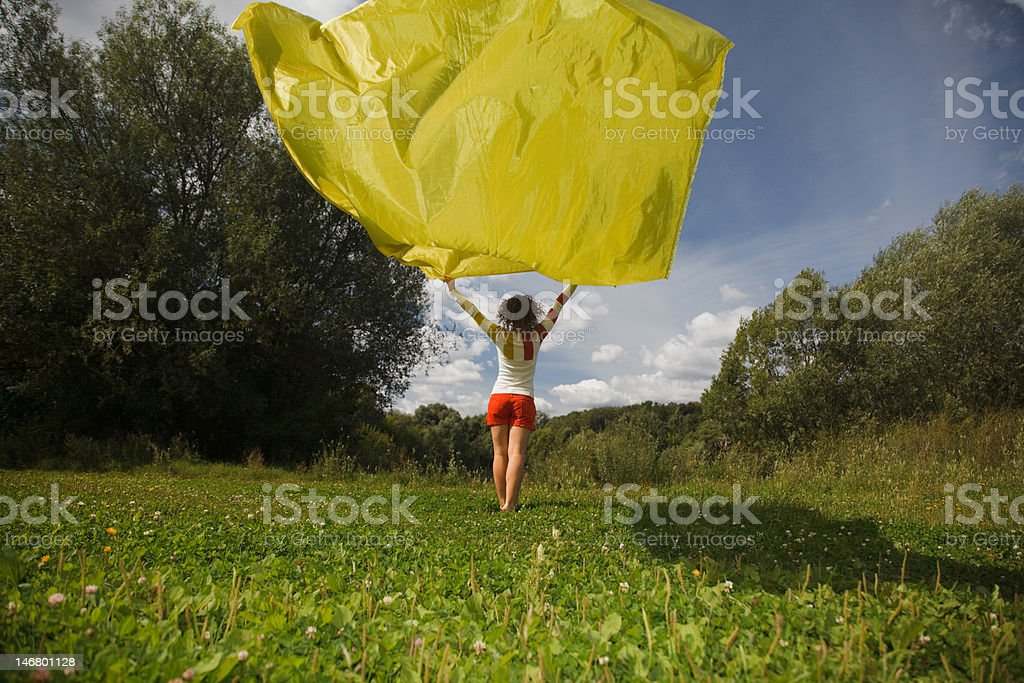 young woman with yellow fabric stock photo