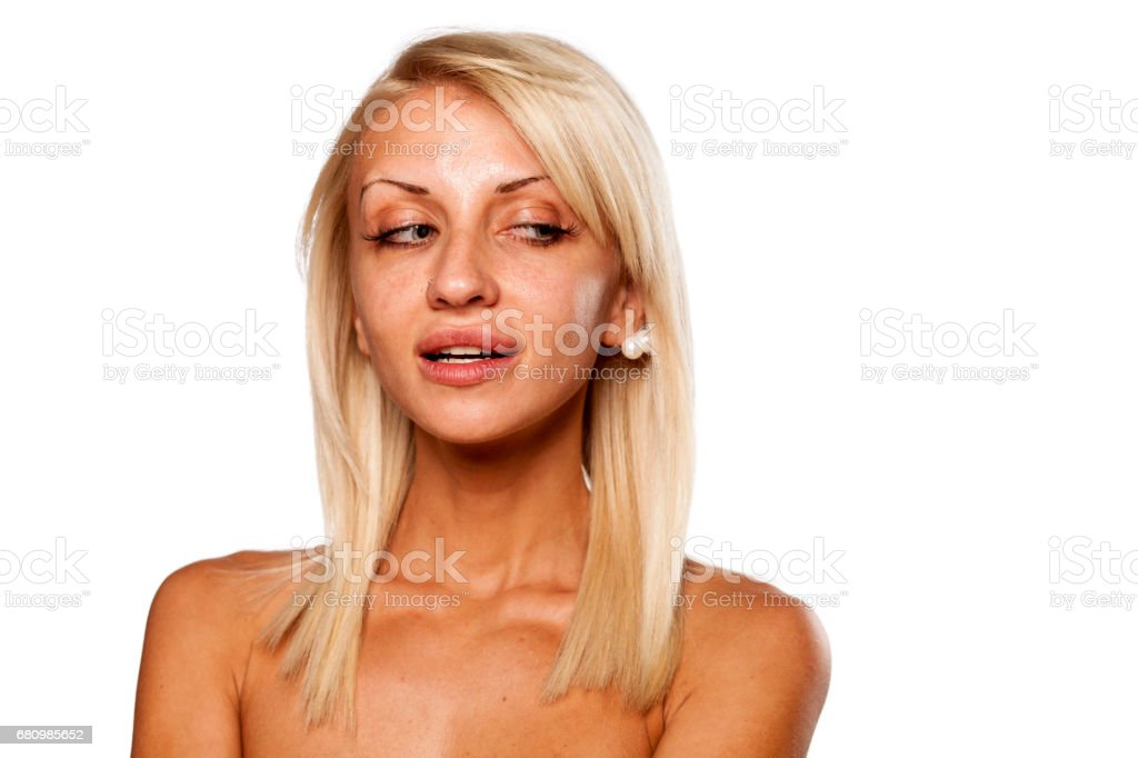 young woman without makeup posing in the studio royalty-free stock photo