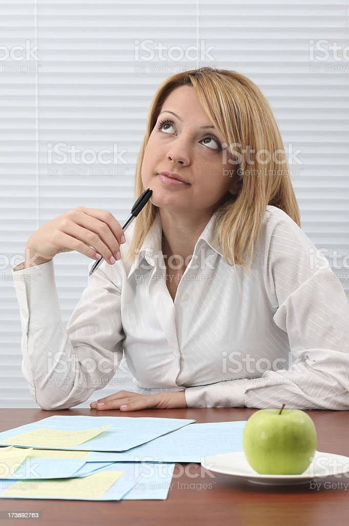 Young Woman Working And Thinking royalty-free stock photo
