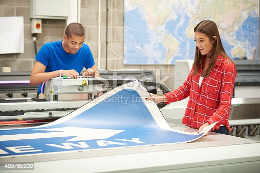istock young woman working at a digital printers 493785200