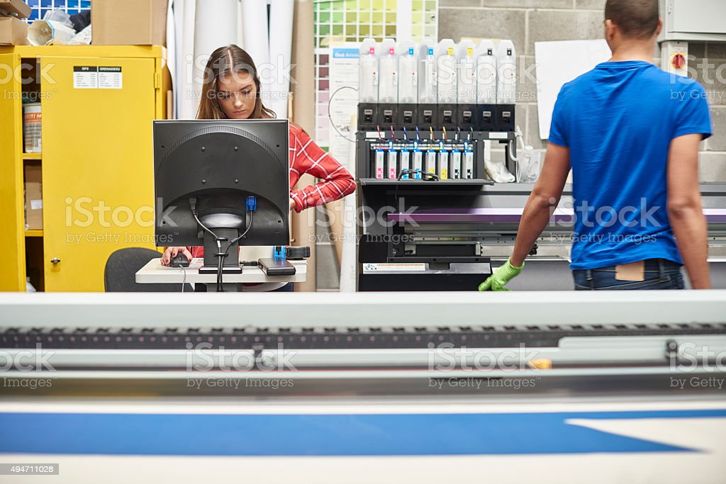 young woman working at a digital printing company stock photo