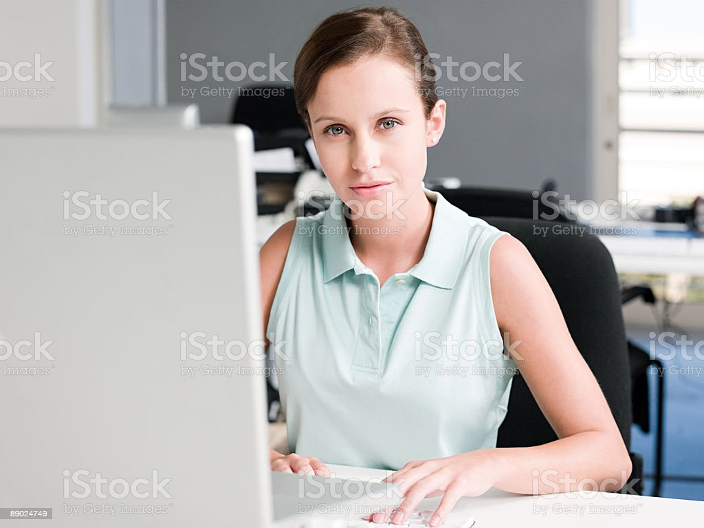 Young woman working at computer royalty-free stock photo