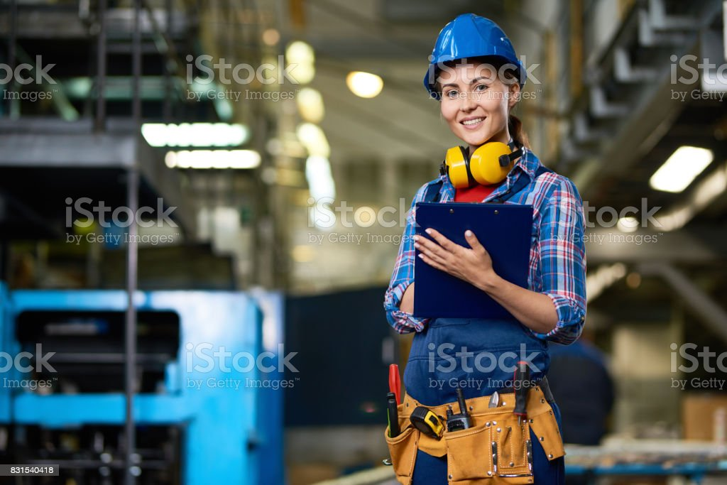 Young Woman Working at Factory stock photo