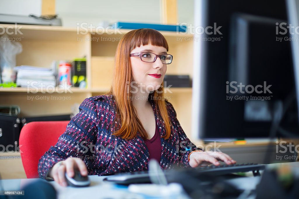Young woman working at her desk stock photo