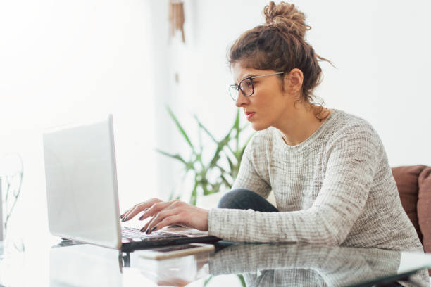 Young woman working at her home. She working at lap top Young woman working at her home. She working at lap top zoom effect stock pictures, royalty-free photos & images