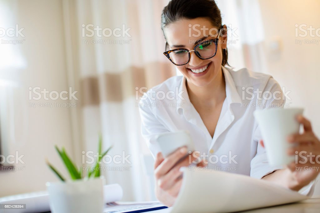 Young woman working at home and drinking coffe royalty-free stock photo