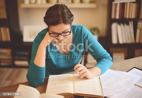 521911045istockphoto young woman working at home (literature) 1019412342