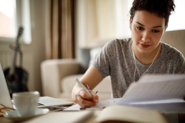Young woman working at home stock photo