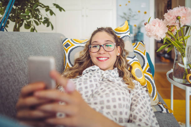Young woman working at home Young woman working at home long distance relationship stock pictures, royalty-free photos & images