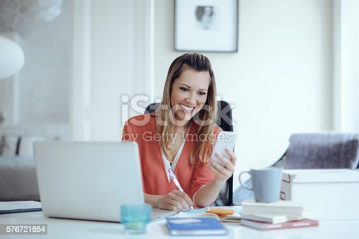 istock Young woman working at home 576721854