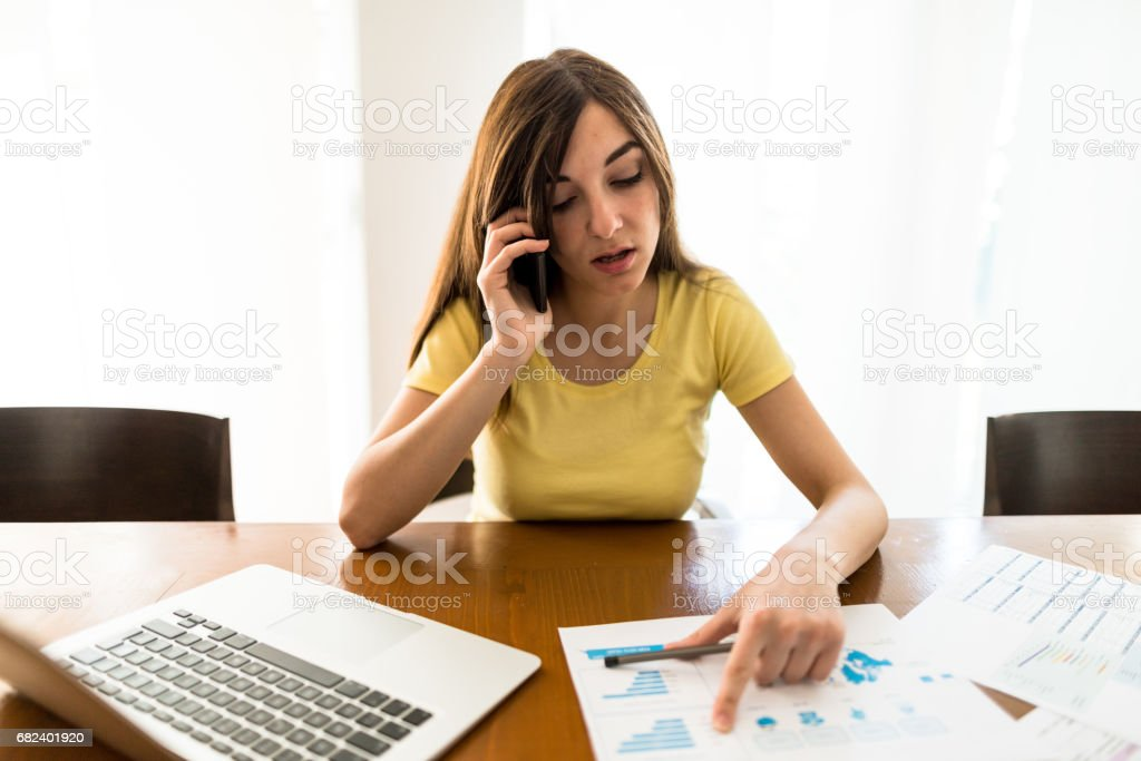 young woman working at home royalty-free stock photo