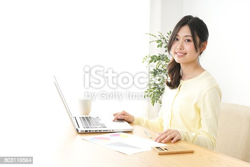 istock Young woman working at office 803119564