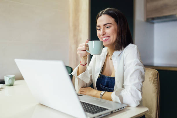 Young woman working casually from home stock photo