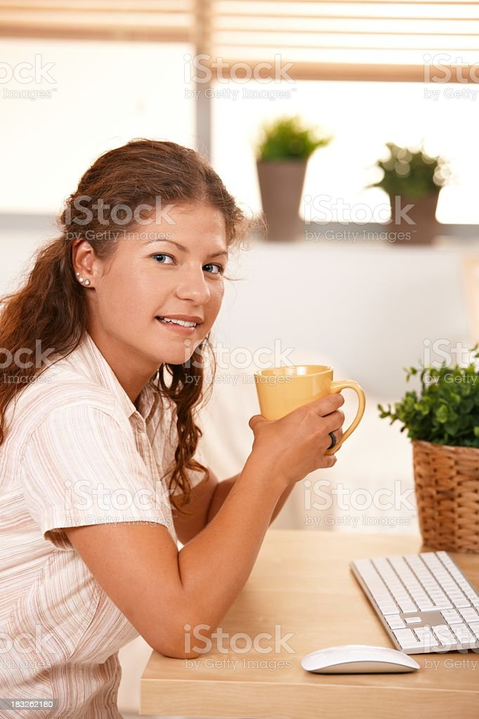 Young woman working computer at home royalty-free stock photo
