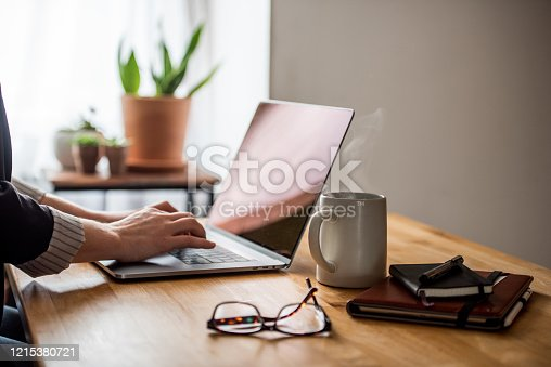 A young woman working from home due to covid-19.