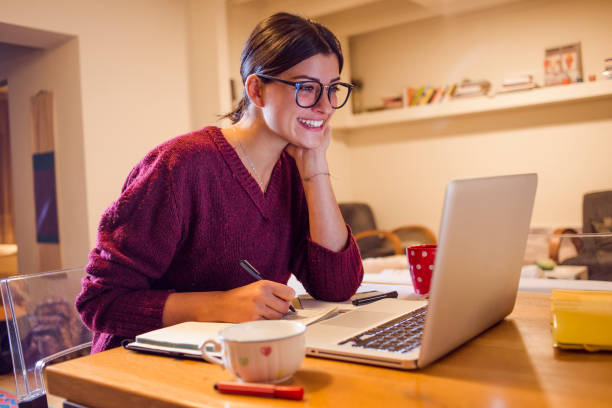 young woman working from home - job search stock photos and pictures