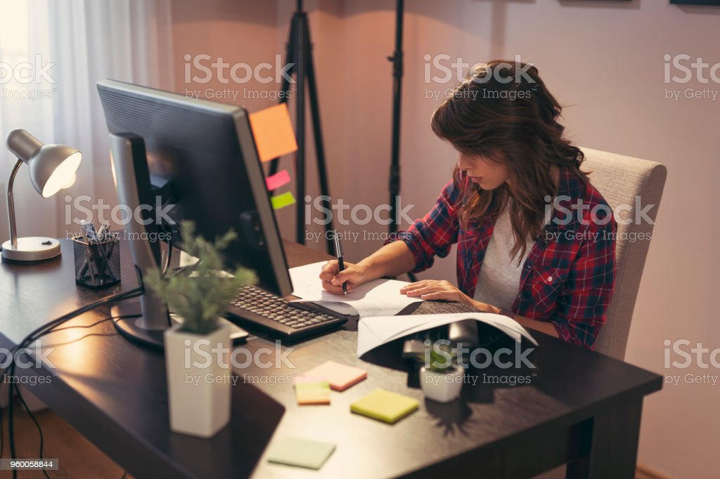 Young woman working in a home office stock photo