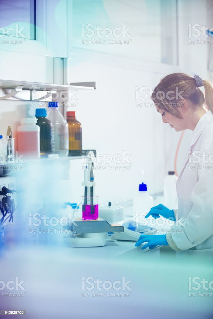 young woman working in a laboratory stock photo