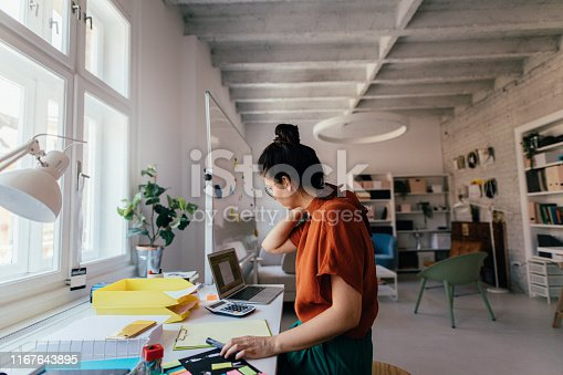 Young woman working in a modern office