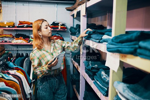 Young woman working in a vintage clothing store in Japan