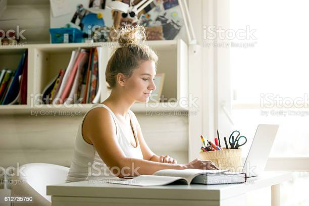 Young woman working in cozy homeoffice picture id612735750?b=1&k=6&m=612735750&s=612x612&h=rwaawcsjzn1klkeuzgagdb0mgpqynfafj rcgtyb wc=