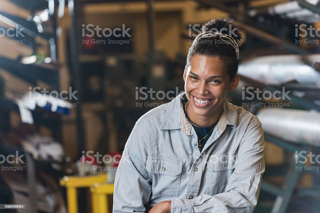 Young woman working in factory stock photo