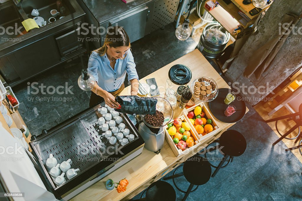 Young Woman Working In Her Cafe stock photo