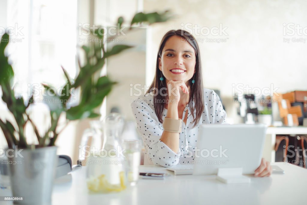 Young woman working in her offfice stock photo