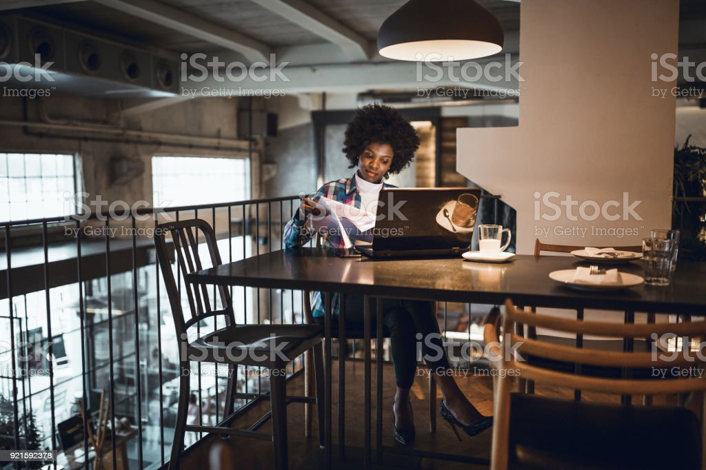 Young woman working in high-end restaurants stock photo
