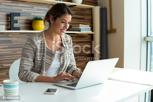 istock Young Woman Working on a computer 614959386