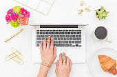 istock Young woman working on a laptop 1178653591