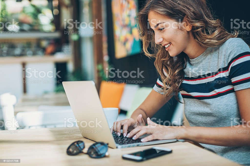 Young woman working on a laptop stock photo