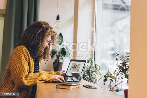 istock Young woman working on a laptop 925516616