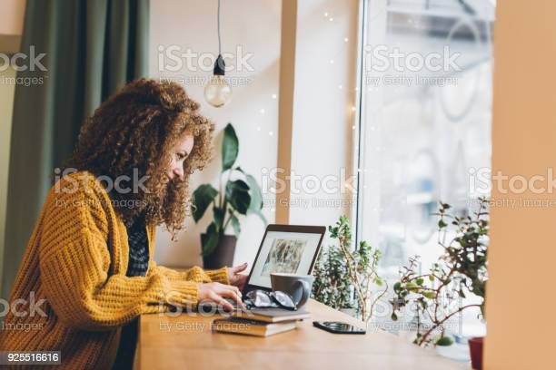 Young Woman Working On A Laptop Stock Photo - Download Image Now