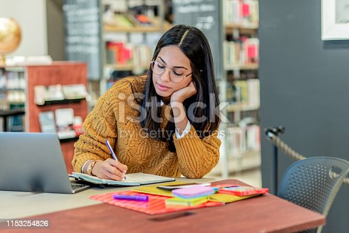 istock young woman working on a project 1153254826