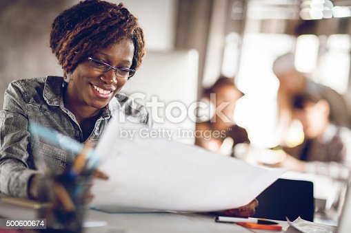 918035432 istock photo Young woman working on a project 500600674