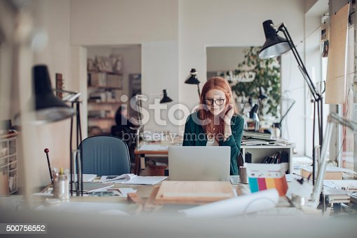506821756 istock photo Young woman working on a project 500756552