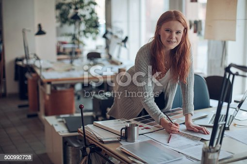 506821756 istock photo Young woman working on a project 500992728