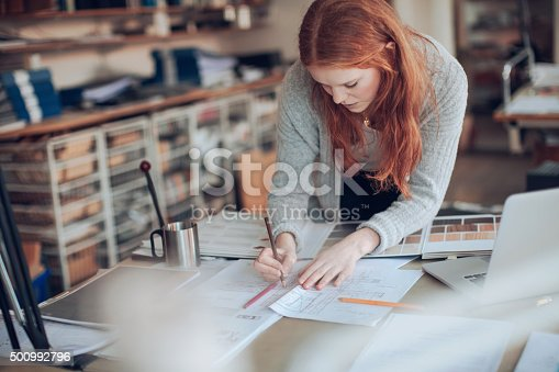 506821756 istock photo Young woman working on a project 500992796