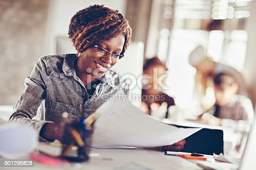 istock Young woman working on a project 501295828