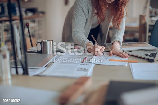 506821756 istock photo Young woman working on a project 503215092